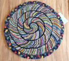 Jane's chair pad with braided edge