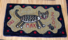 Max, another of Susie's rugs